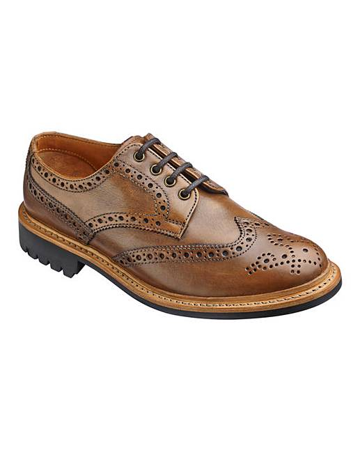 brogue chat Tommy hilfiger men's shoe the dress shoe classic every man must own is crafted from durable leather with perforated detail and a slight patina for that vintage look.