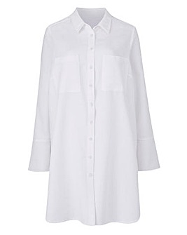 Oversized shirt with curved hem