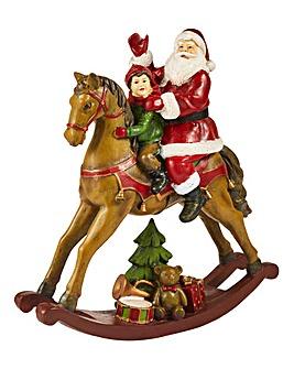 Santa & Child Sat on A Rocking Horse