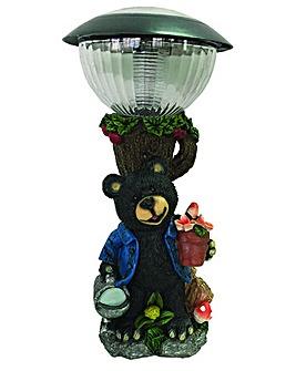 Bear under Solar Post